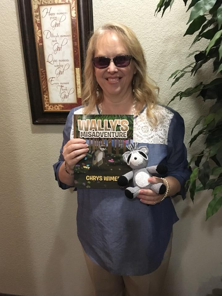 Chrys Wimer holding her book littlewally