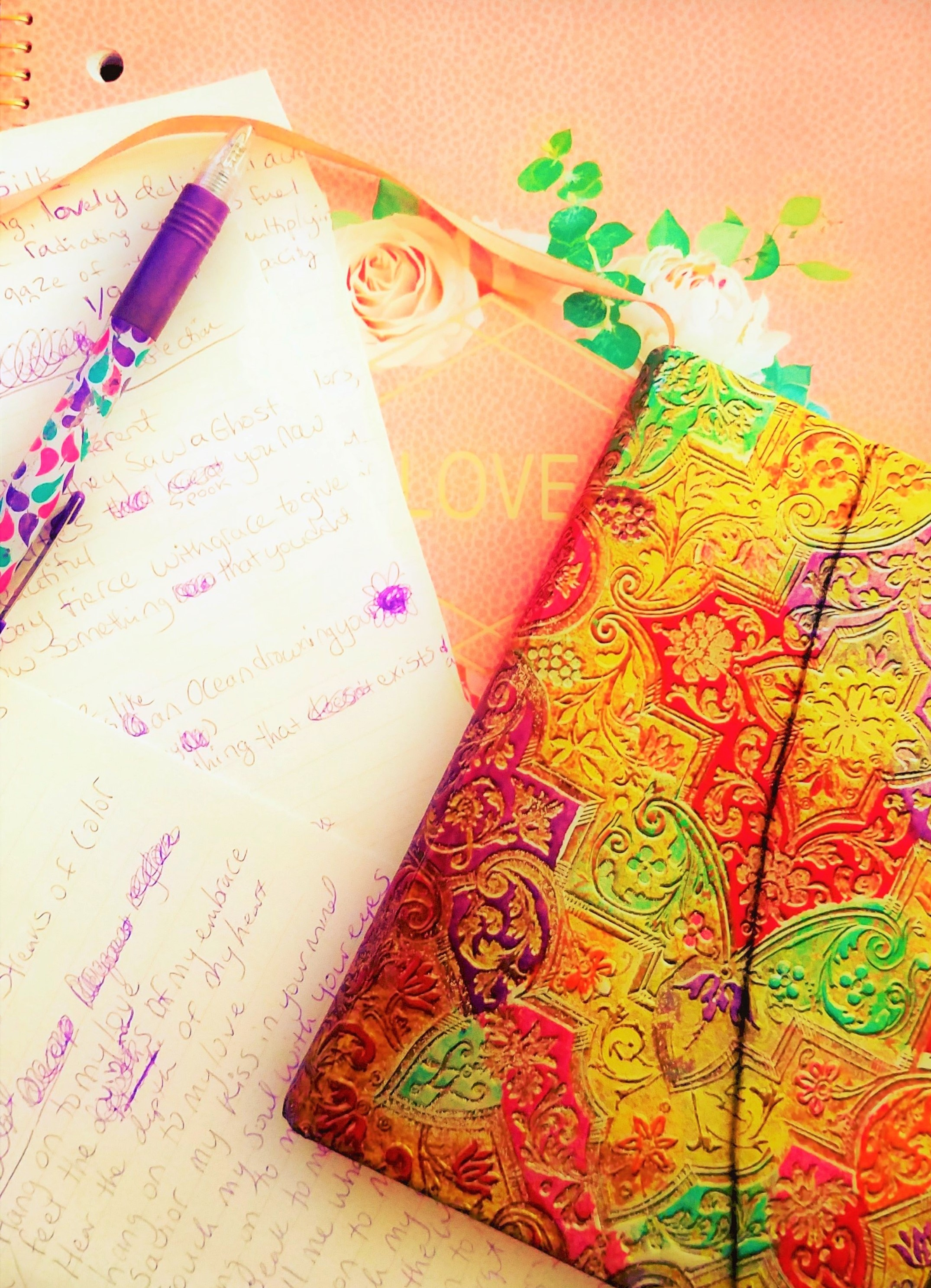colorful open notebook and pen